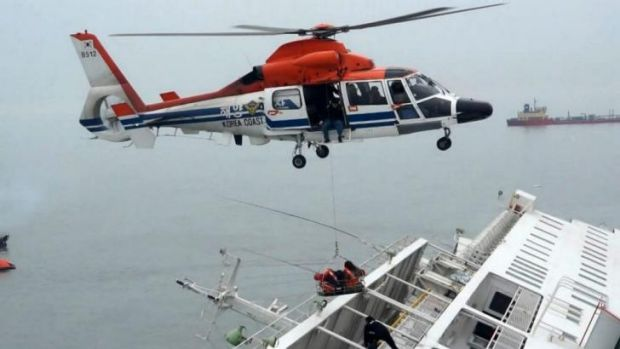 "A maritime police helicopter rescues passengers who were on-board South Korean ferry ""Sewol"", which capsized off Jindo."