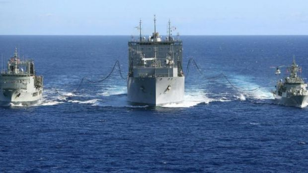 On the water ... HMA Ships Success and Toowoomba replenish supplies at sea with United States Navy Ship Cesar Chavez.