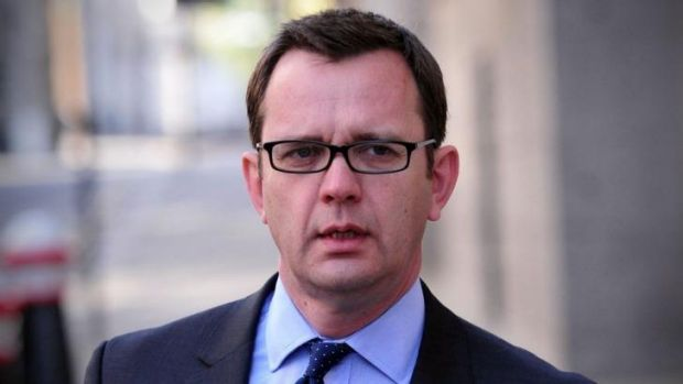 Former <i>News of the World</i> editor Andy Coulson arrives at court in London.