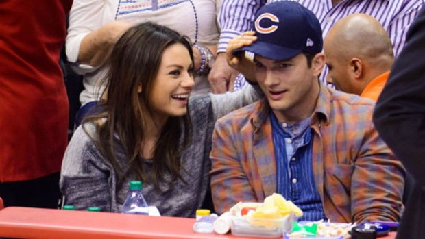Mila Kunis and Ashton Kutcher attend a basketball between the Detroit Pistons and the Los Angeles Clippers at Staples ...