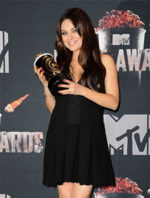 Actress Mila Kunis poses in the press room at the 2014 MTV Movie Awards at Nokia Theatre L.A. Live on April 13, 2014 in ...