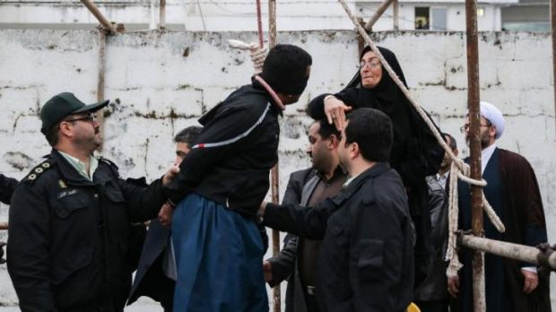 Saved by a slap ... Samereh Alinejad (right) hits Balal, who killed her son, during an execution ceremony in the ...