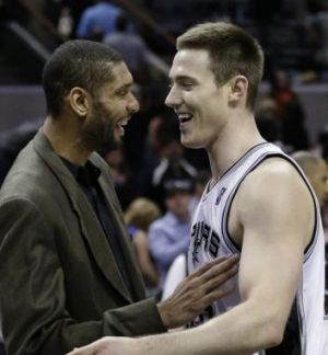 In good company: Australia's Aron Baynes with NBA legend and Spurs great Tim Duncan.