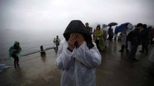 A relative of a missing ferry passenger at Jindo.