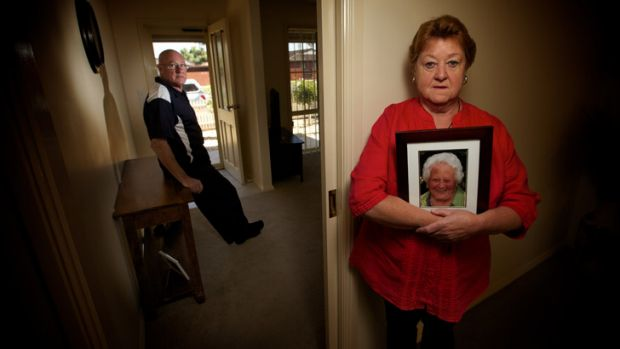 No answers: Joan Hoskins - holding a picture of her late mother, Mary Thomas - and her husband, Robert.