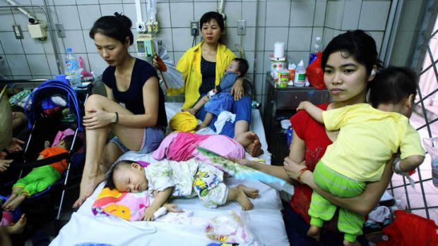 Families with children suffering from measles at a hospital in Hanoi.