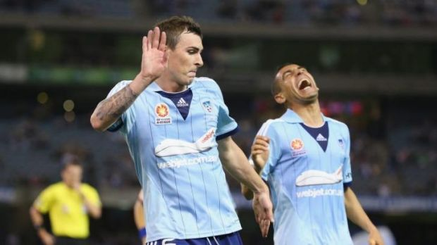 Sebastian Ryall of Sydney FC celebrates after levelling the score at 1-1 as Ali Abbas laughs.