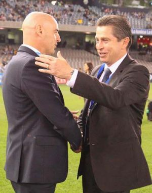 Victory coach Kevin Muscat and his Sydney FC counterpart Frank Farina shake hands before the A-League elimination final ...