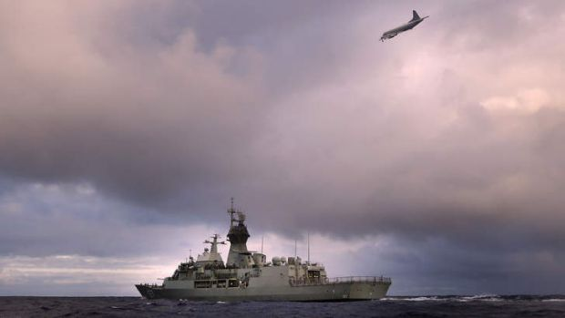 The search continues: An Orion P-3K of the Royal New Zealand Air Force flies over the HMAS Perth in the southern Indian ...