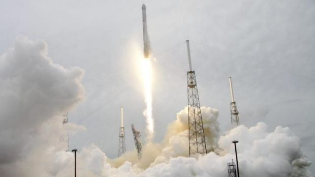 A rocket carrying the SpaceX Dragon ship lifts off from launch complex 40 at the Cape Canaveral Air Force Station in ...