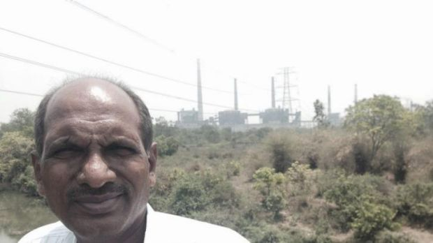 Suresh Chopne, founder of Green Planet, in front of a coal fired power station built on the edge of Chandrapur.