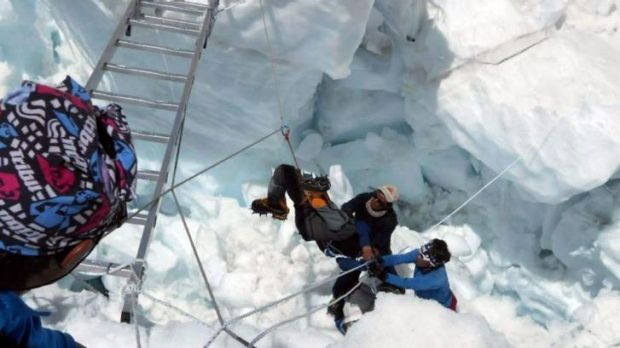 Nepalese rescue team members help a survivor of the avalanche.