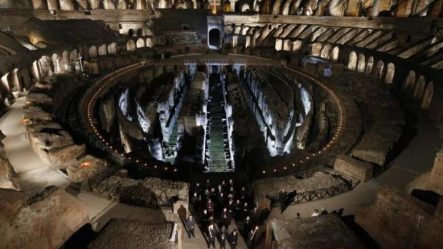 Pope Francis leads the Via Crucis procession at the Colosseum in Rome.