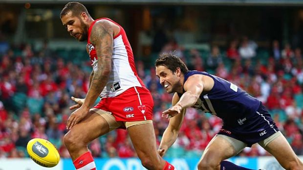 Lance Franklin competes with Luke McPharlin.