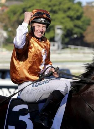 Rising talent: James McDonald celebrates victory in the $1 million Australian Oaks.