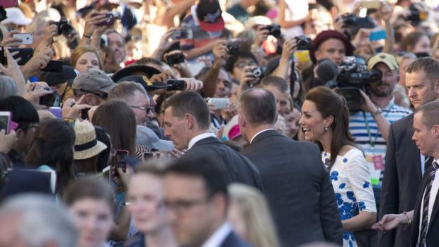 Catherine, Duchess of Cambridge is swamped by supporters at South Bank.