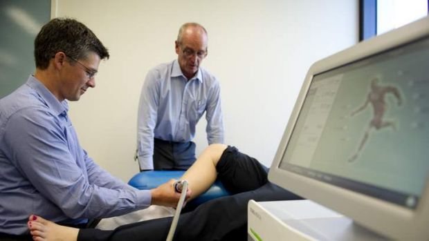Assistant Professor Physiotherapy Phil Newman and Professor Physiotherapy Gordon Waddington with the Storz Medical ...