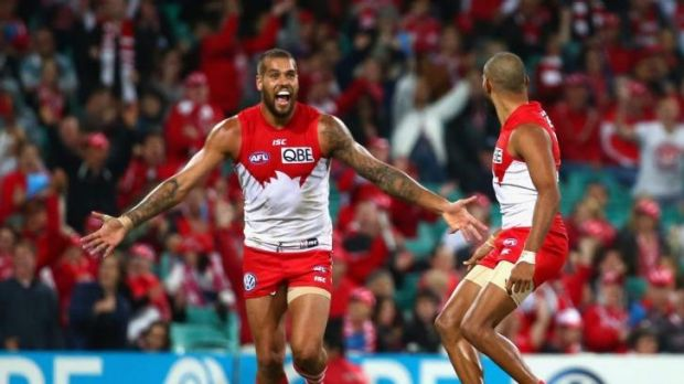 Four stars: Lance Franklin celebrates one of his four goals for the Swans in a stirring performance.