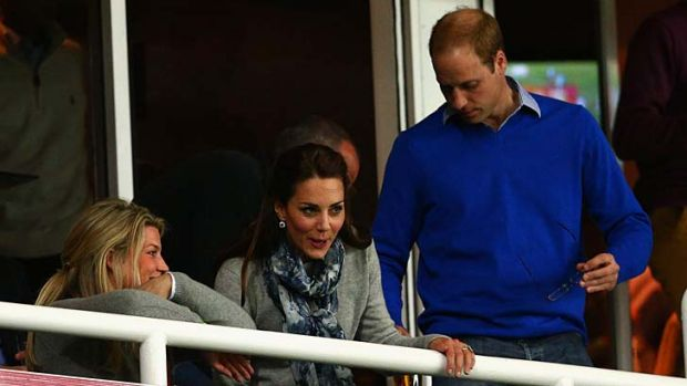 The Duke and Duchess take their seats in a private box for the game.