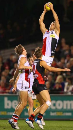 On high: Saint Sean Dempster takes a big grab.