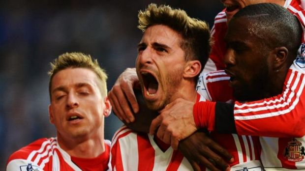Jubliant: Fabio Borini, centre, celebrates after scoring a penalty to secure Sunderland an upset win over Chelsea and, ...