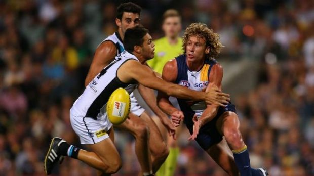Matt Priddis of the Eagles handballs during the round five AFL match between the West Coast Eagles and the Port Power at ...