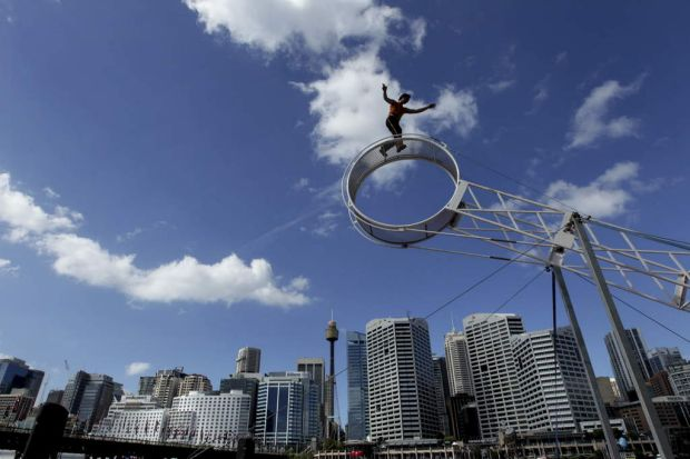 Street performers and aerial acrobats thrill the crowds.