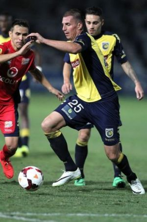 Furious: Mariners defender Eddy Bosnar tries to navigate past Adelaide United at Gosford on Saturday night.