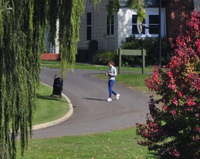 Duchess of Cambridge and Prince George walk around the lawns of Government House in Canberra during a break in their ...