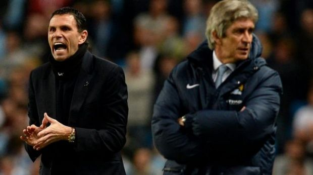 The Nearly Man: Manuel Pellegrini (R) with Sunderland's manager Gus Poyet.
