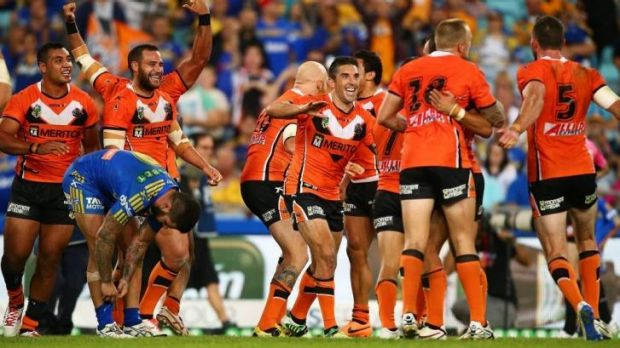 In the bag: The Tigers celebrate at the final whistle