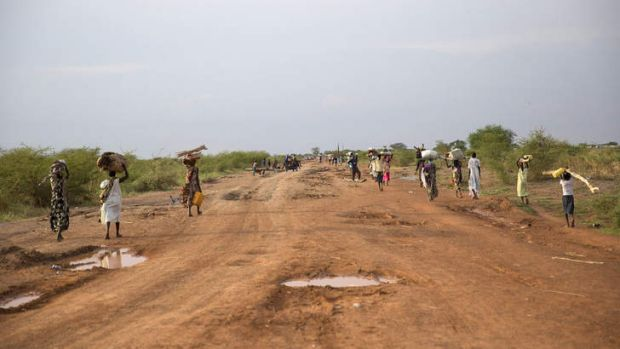 Running for the lives: Civilians flee from renewed attacks in Bentiu.