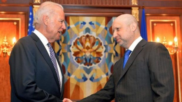 Firm support ... US Vice President Joe Biden, left, is greeted by Oleksandr Turchynov, the acting Ukrainian prime minister.