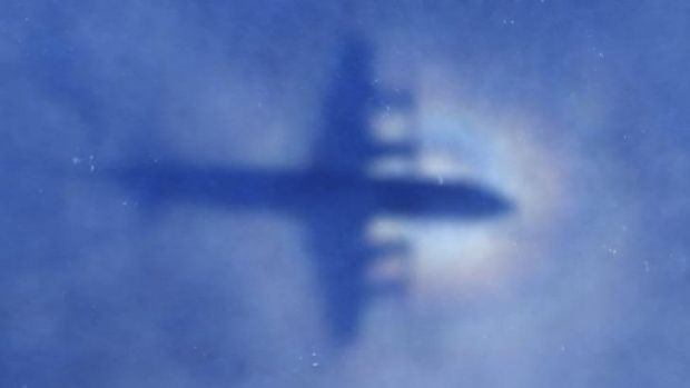 Shadow of a Royal New Zealand Air Force P-3 Orion aircraft is seen on low cloud cover while it searches for missing ...