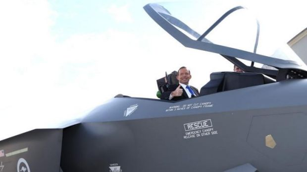 Prime Minister Tony Abbott in the cockpit of a replica Joint Strike Fighter. The government will buy 58 jet fighters.