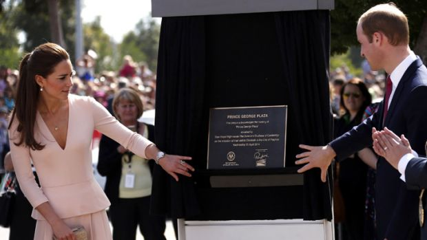 The Duke and Duchess unveil a plaque renaming a plaza in Elizabeth in honour of their son.