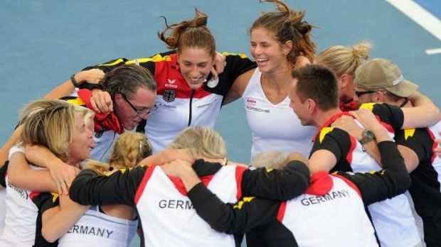 Anna Petkovic and Julia Goerges of Germany celebrate with teammates after defeating Australia in a Fed Cup semi-final ...