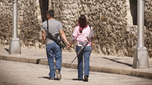 Romantic stroll: Demonstrators leave a pro-gun rally at the Alamo in San Antonio, Texas, last October.