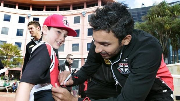 St Kilda's Trent Dennis-Lane with a young fan.