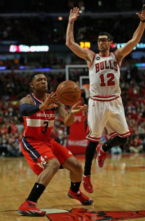 Smooth moves: Bradley Beal (left) scored a game-high 26 points against Chicago.