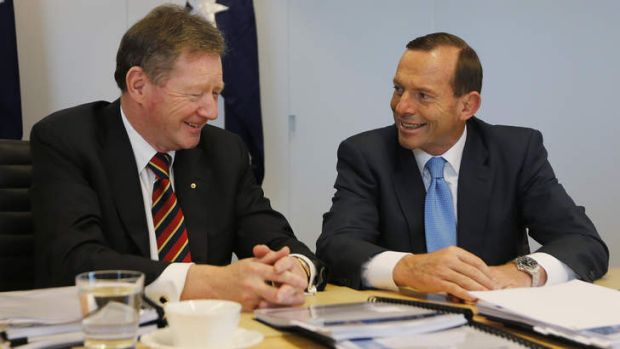 Pay rise: Secretary of the Department of the Prime Minister and Cabinet Ian Watt talks to Prime Minister Tony Abbott.