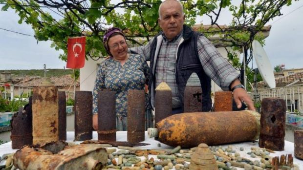 Ali Gul and his wife Gulumser Gul,Turkish farmers display their collection of military artifacts.
