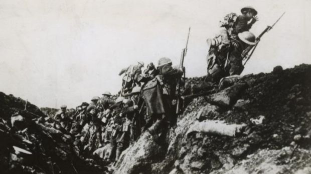 Australian infantrymen on the Western Front clamber over the top of a trench in France on a bayonet charge towards the ...