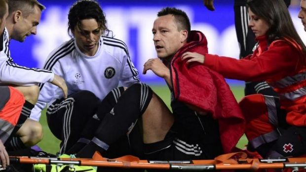 Chelsea captain John Terry is carried out on a stretcher after sustaining an injury during the Champions League first ...