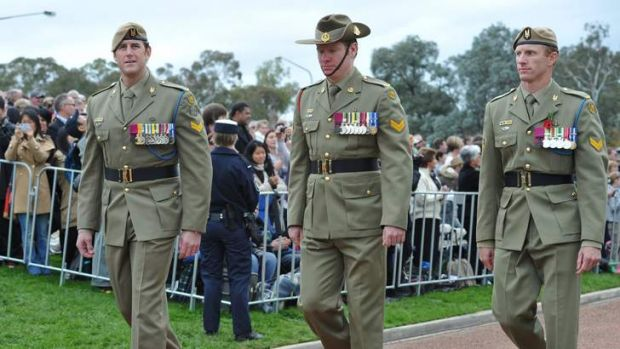 Marching are VC recipients (from left) Ben Roberts-Smith, Daniel Keighran and Mark Donaldson.
