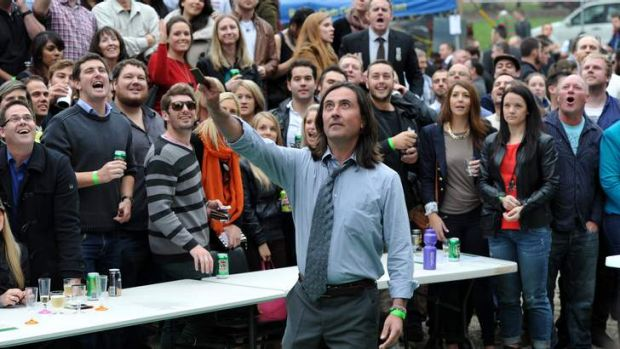 British broadcaster, Prof. Neil Oliver takes on the role of spinner in a two-up game at the site of the Canberra ...