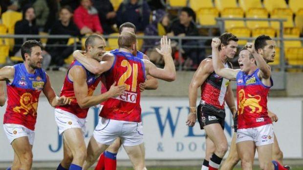Brisbane's Trent West and Daniel Merrett celebrate a goal.