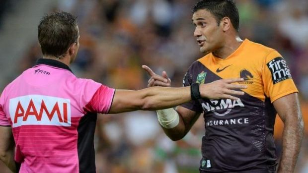 Broncos captain Justin Hodges argues with referee Gavin Badger.