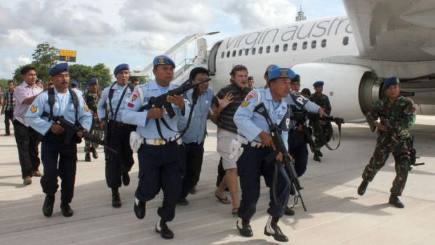 Matt Lockley being arrested by Indonesian Air Force soldiers after landing on the Virgin Australia 737-800 plane at ...