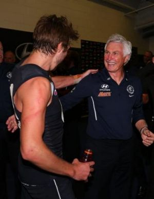 Mick Malthouse and Dale Thomas celebrate the win.